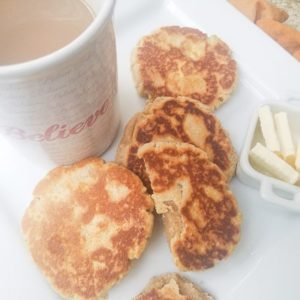Gorditas de Azucar on a white platter served with butter and coffee.