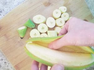 Peeling green plantains for the Bolón de Verde.