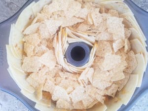 Crushed tortilla chips on top of cheese.-Taco Ring