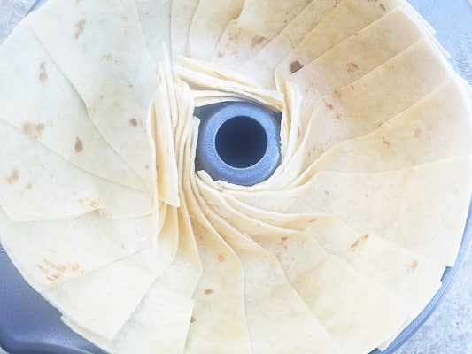 Flour tortilla strips in a fanning pattern for beef taco ring.