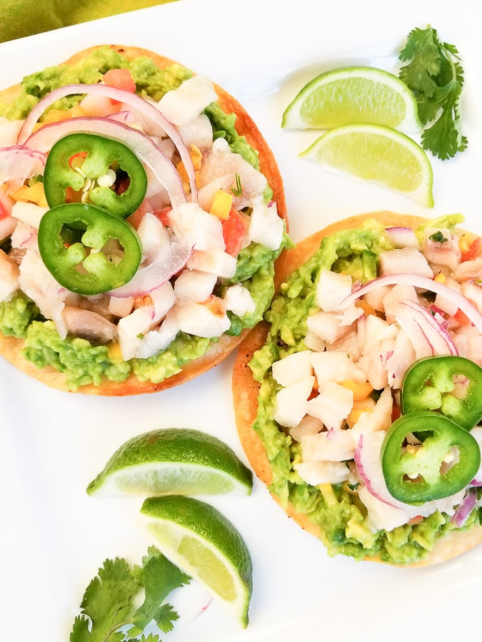 Tilapia Ceviche Tostadas served on a white platter.