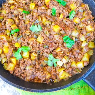 Carne Molida (Puerto Rican Picadillo) cooked in a skillet.