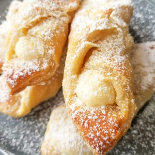 Quesitos (Cream Cheese Puff Pastry) on a gray plate.