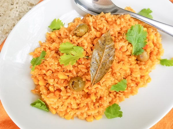 Puerto Rican Yellow Rice served in a large white platter for self serve.