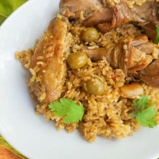 Cooked Puerto Rican Rice with Chicken and served in a large white platter.