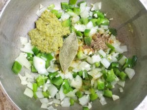 Ingredients for the salsa criolla in a caldero.