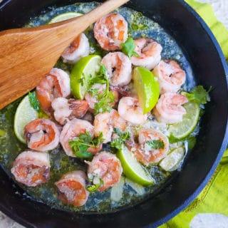 Delicious Camarones al Ajillo cooked in a cast iron skillet.