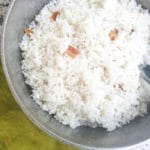 Arroz Blanco (Puerto Rican White Rice) cooked in a caldero with pieces of tocino (pork fat).