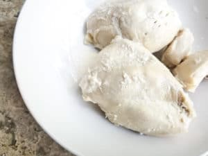 Boiled chicken for the Salpicon in a white bowl.