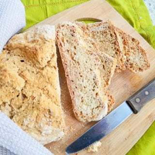 Irish Soda Bread sliced on a wooden cutting board.