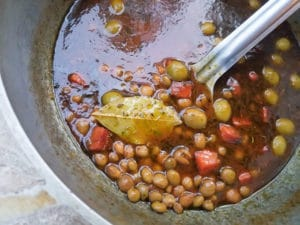 The cooking base for the Arroz con Gandules in a caldero.