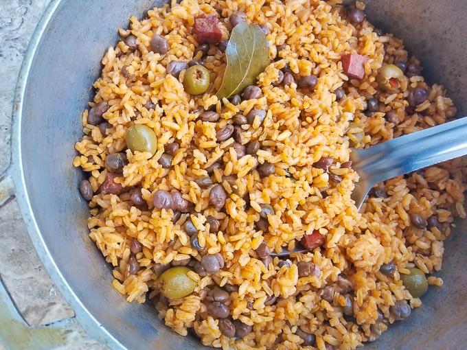 Cooked Arroz con Gandules (Pigeon Peas and Rice) in a caldero (cast aluminum pot).