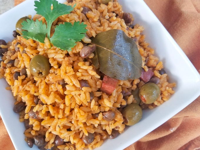 Arroz con Gandules (Pigeon Peas and Rice) in a white bowl.
