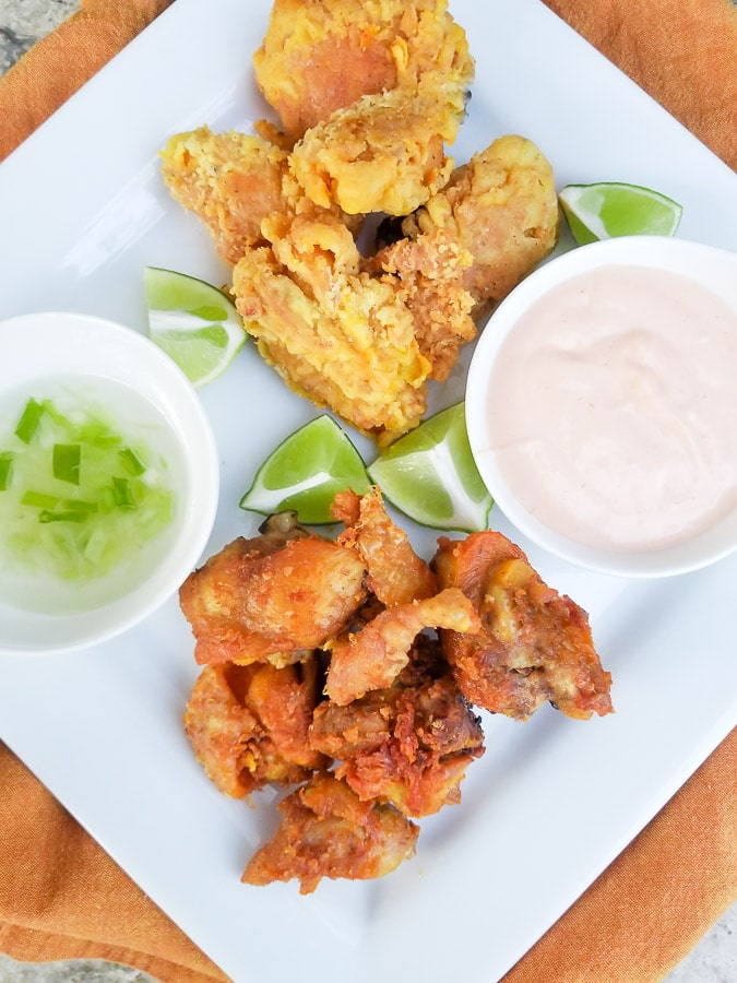 Chicharrones de Pollo served with a garlic aioli and mayoketchup sauce.