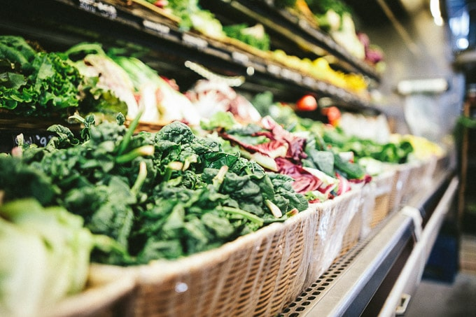 Fresh veggies and fruits in supermarket shelves.
