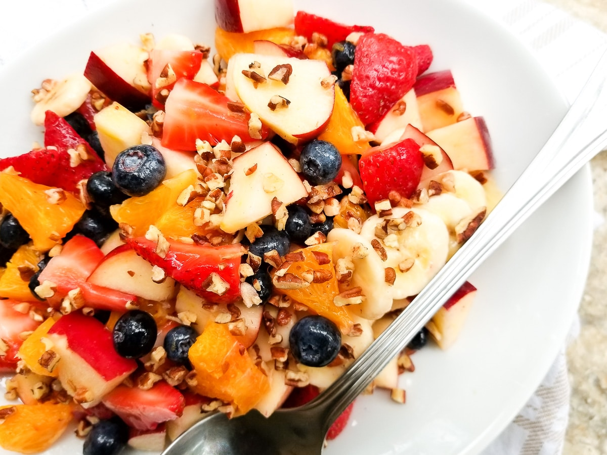 Ensalada de Frutas (Fruit Salad) served in a white platter.
