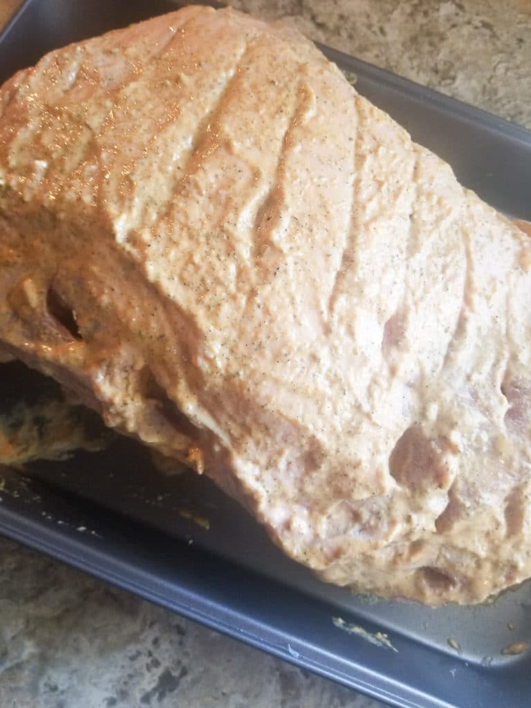 Well seasoned pernil ready to cook in the oven.