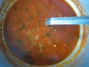 Salsa Criolla cooking in a caldero.