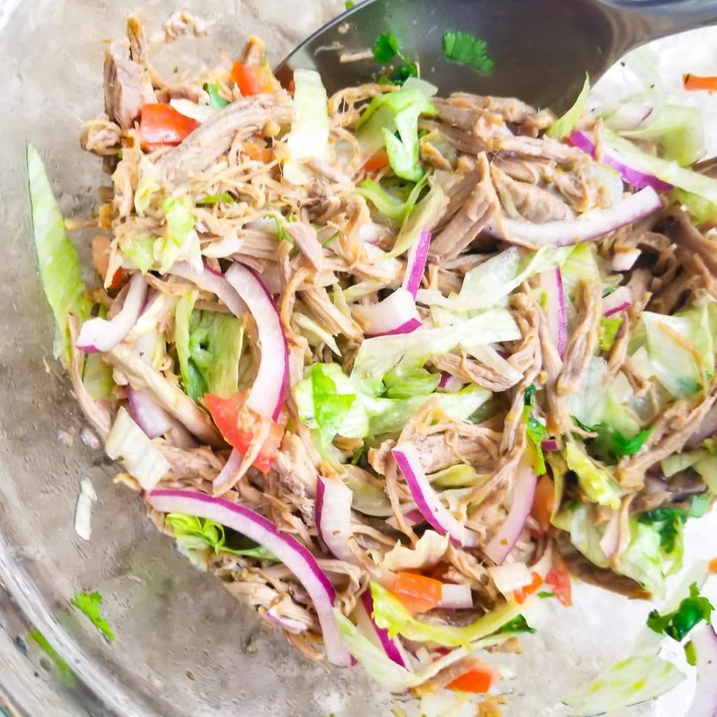 Shredded beef, veggies and seasonings mixed well for ensalada desalpicon.