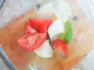 Vegetables in a blender to make refrito for the sango.