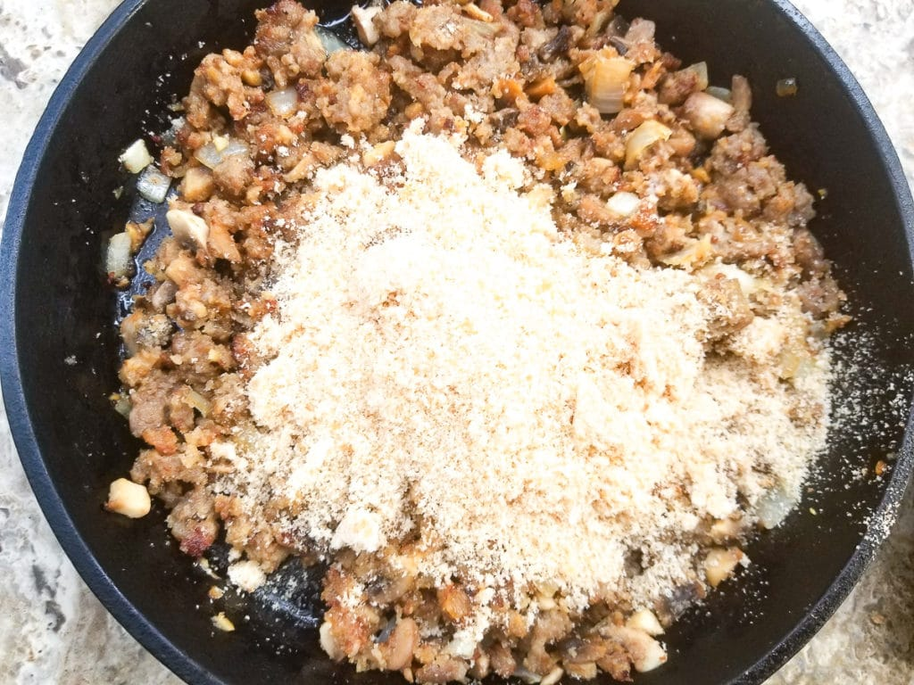 Breadcrumbs added to skillet for stuffed mushrooms.