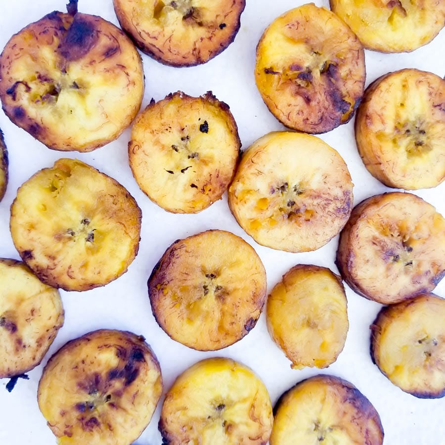 A plate full of cooked plantains ready for plantain omelette.